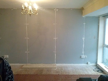 Membrane fitted to wall